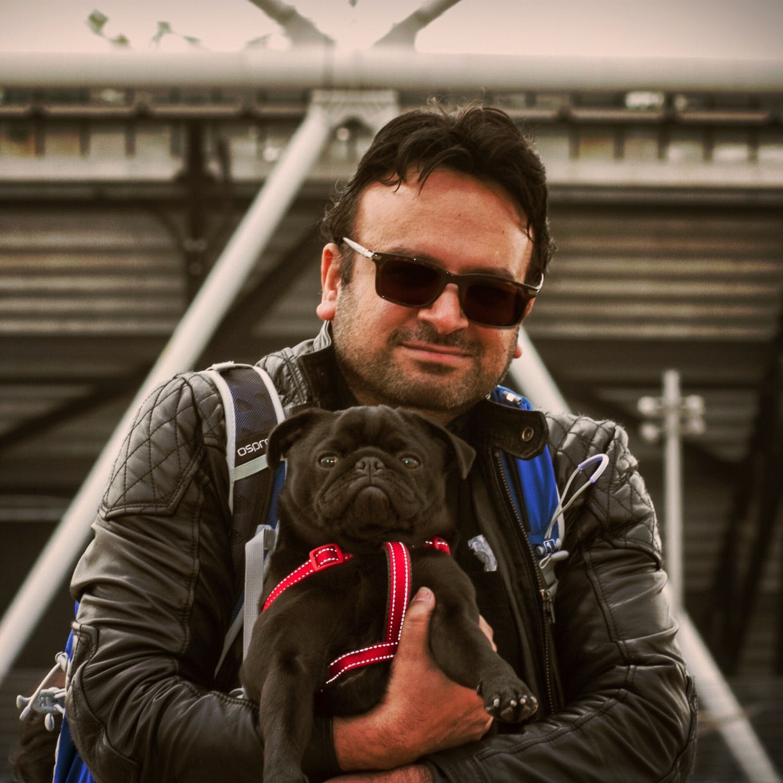Kris Sangani holding a pug
