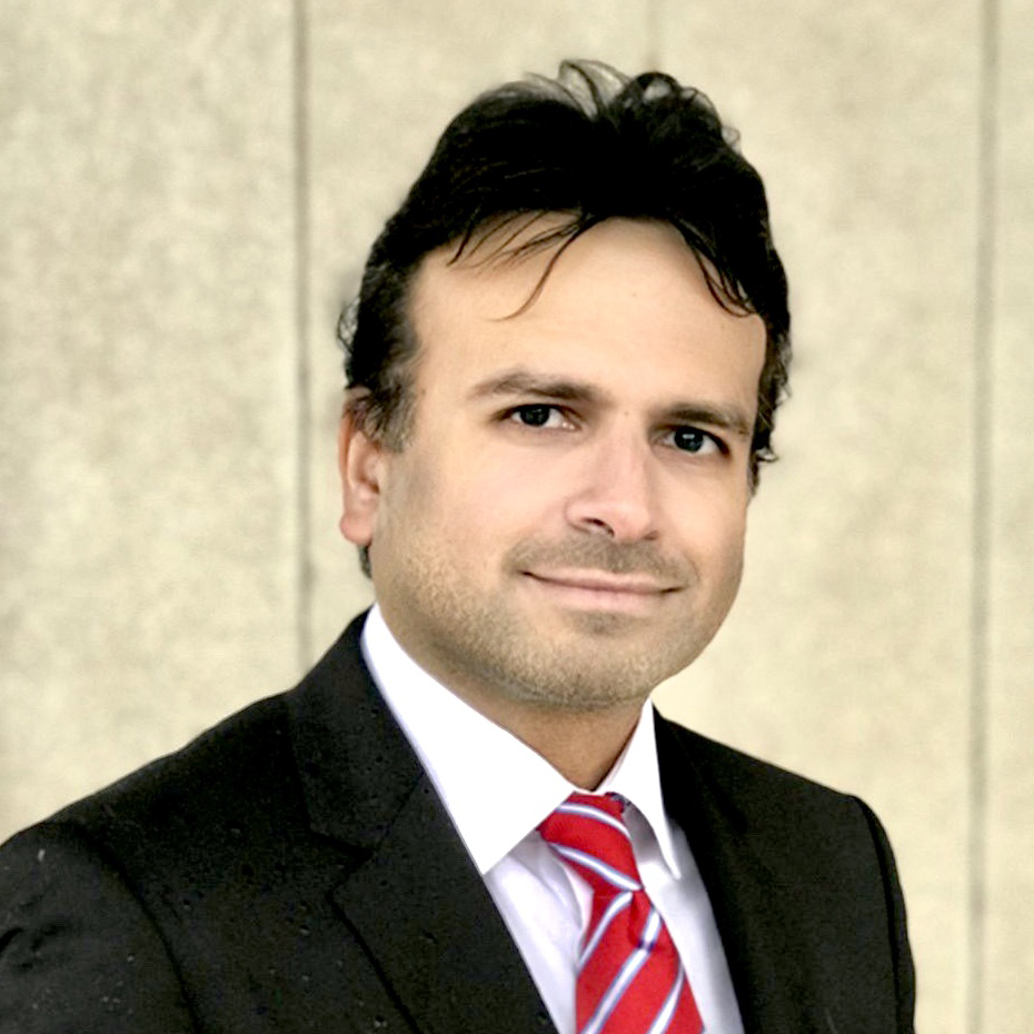 Kris Sangani in a business suit